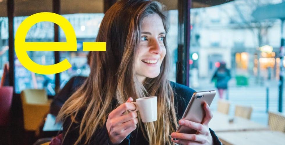 Lady on phone drinking coffee